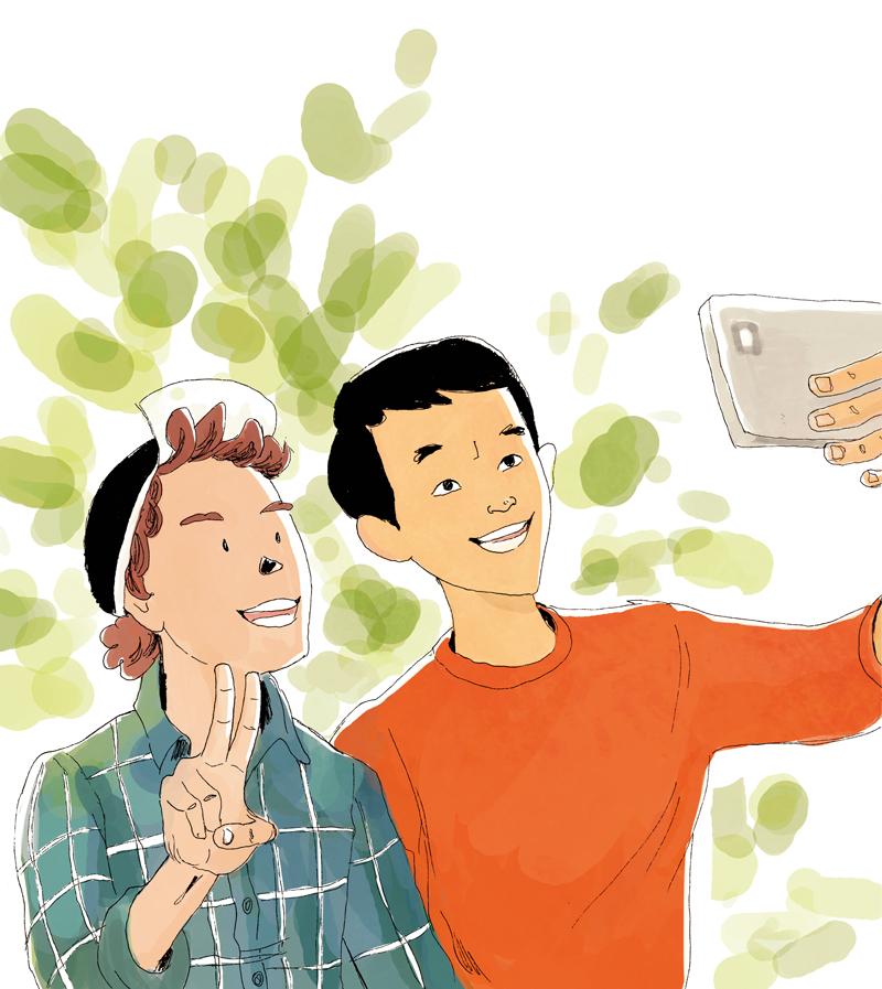 Zwei junge syrische Flüchtlinge machen ein Selfie für ihre Eltern.